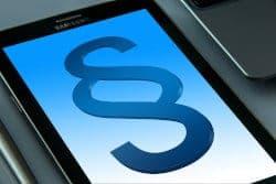 Symbol klauzuli na smartphonie